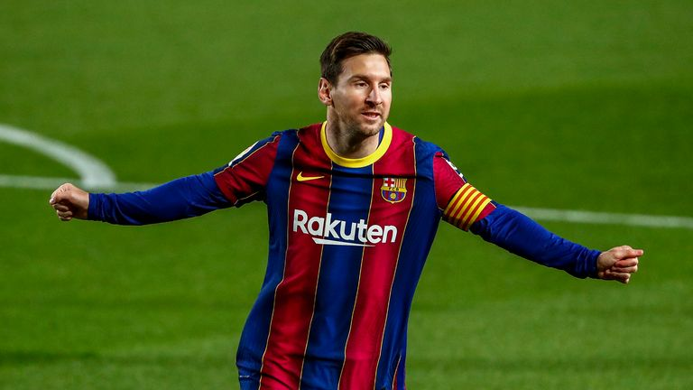 Barcelona's Lionel Messi celebrates after scoring the opening goal during the Spanish La Liga soccer match between FC Barcelona and Getafe at the Camp Nou stadium in Barcelona, Spain, Thursday, April 22, 2021.